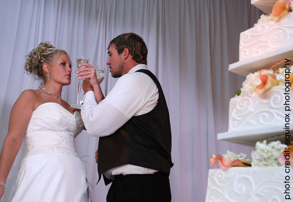 bride and groom toasting what wedding traditions should you keep? part one