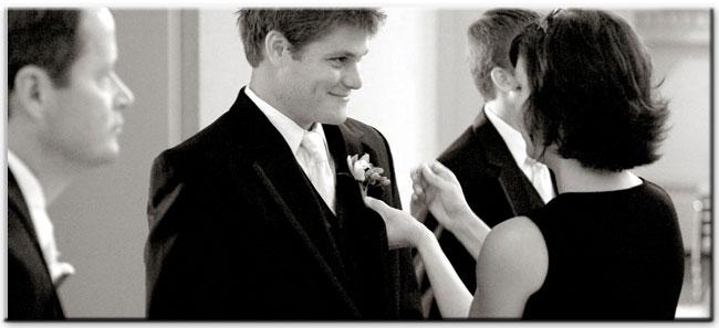wedding planner pinning flowers