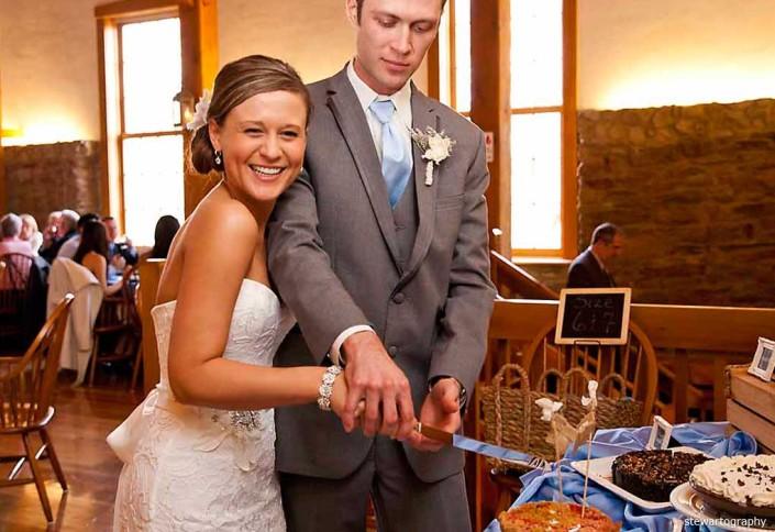 cutting the cake wedding reception